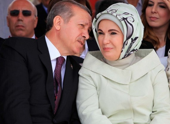 "Turkish Prime Minister Recep Tayyip Erdogan talks to his wife Emine during the opening ceremony of the third Bosphorus bridge on May 29, 2013 in Istanbul. Turkish Prime Minister Recep Tayyip Erdogan laid the first stone of the third Bosphorus bridge, a multi-billion dollar construction project expected to deliver the world's widest overpass. ""When the project is completely finished, it will alleviate the burden of Istanbul, one of the most important transit corridors of the world,"" Erdogan said during the groundbreaking ceremony held on the European leg of the giant project. AFP PHOTO/MIRA"