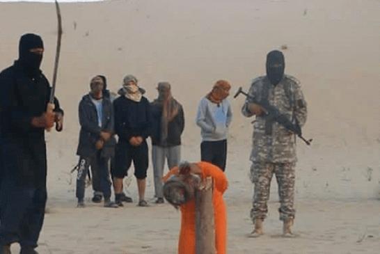 داعش يعدم شيخا ضريرا عمره 100 عام + (صور)